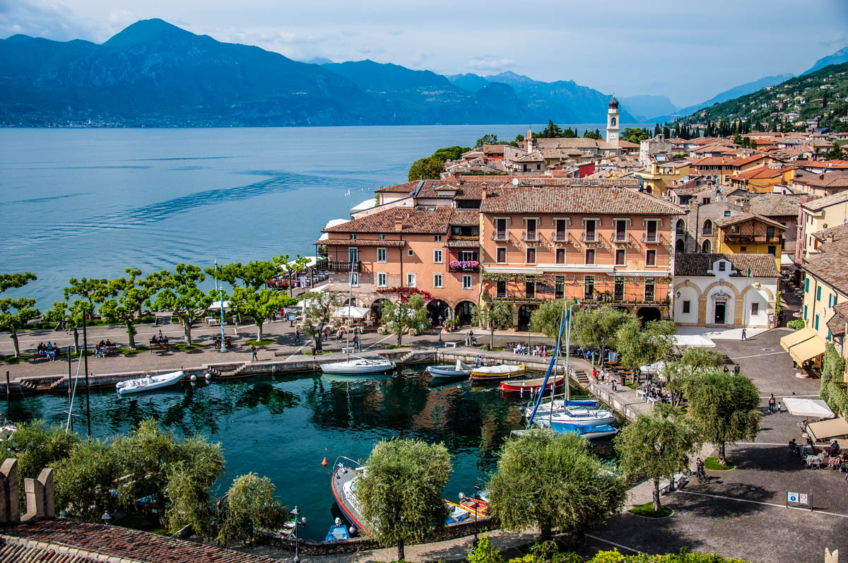 View of the historic harbour and the historic centre from the medieval Scaliger Castle - Torri del Benaco, Italy - rossiwrites.com